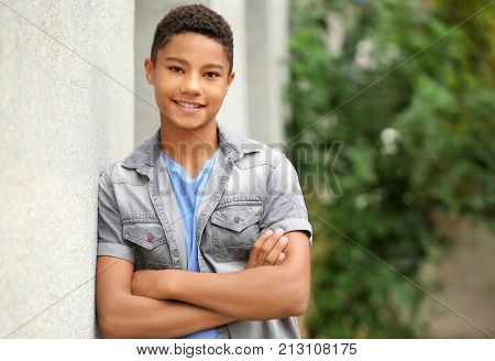 Charming African-American teenager on city street