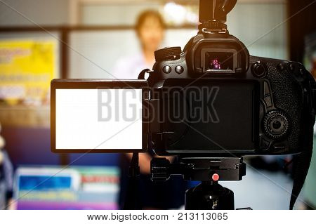 Woman on set Video camera camcorder interviews operator working for record speaker or Presenter in office blak white screen.