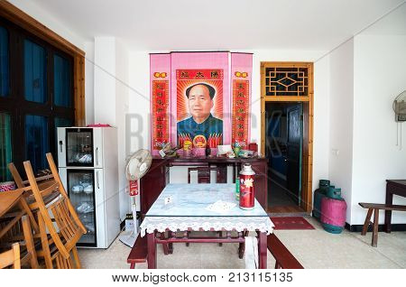JIANGXI PROVINCE, CHINA - AUG 6, 2014 - Chairman Mao poster inside a Chinese dining room