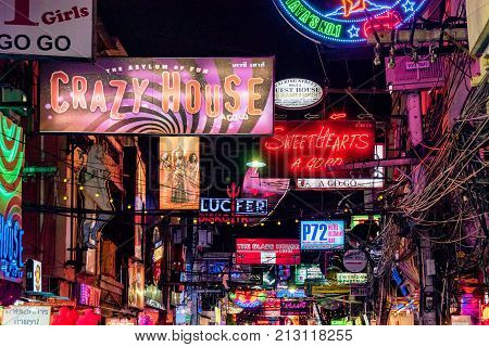 PATTAYA THAILAND - AUGUST 07: Neon signs for bars and clubs in the famous Walking Street red light district on August 07 2017 in Pattaya