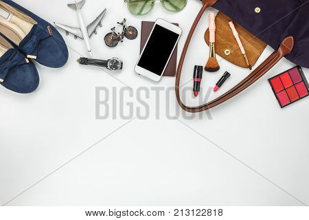 Table top view of accessories women for travel concept.Fashionable female and mobile phone also essential cosmetic in handbag.item for traveler adult or teenage to vacation.Object on white background.