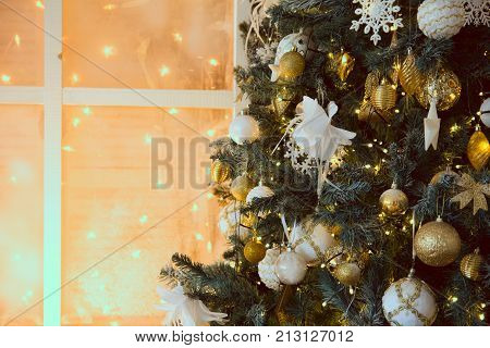 Decoration with a Christmas tree and a background of burning garlands. Ornaments on a Christmas tree