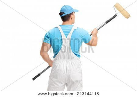Rear shot of a painter with a paint roller isolated on white background