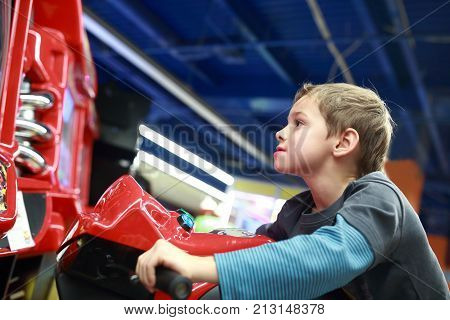 Child Playing In Motorcycle Simulator