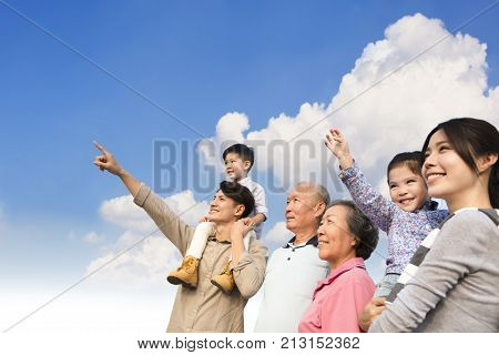 Multi generation family having fun together outdoors