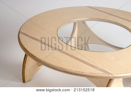 Angled Top View Of Bare Wood Designer Round Table