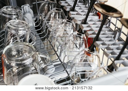 Clean glass cups and glasses after washing in a dishwasher. Dishwasher inside close-up