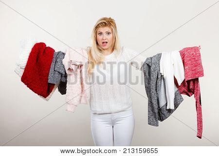 Woman Holding Big Piles Of Clothing