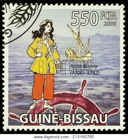 Moscow Russia - November 09 2017: A stamp printed in Guinea shows Anne Bonny - an Irish woman a famous pirate in the Caribbean series