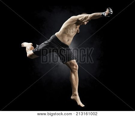 mma fighter flying with a punch isolated