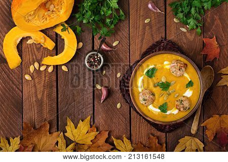 Delicious Cream Of Pumpkin Soup With Meatballs Made Of Turkey Minced Meat In A Bowl On A Wooden Tabl