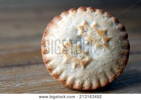 Close Up Of A Mince Pie, A Traditional Christmas Dessert, On A Wooden Table