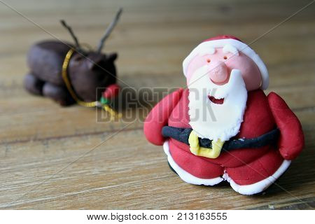 Close Up Of A Home Made Sugarcraft Father Christmas, Or Santa Claus, Made From Icing Or Fondant, To