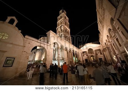 SPLIT, CROATIA - MAY 19, 2017: Tourists in Peristyle Palace of the Emperor Diocletian in the evening