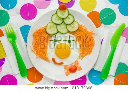 Clown fun breakfast edible clown face made from vegetables and fried egg party food idea
