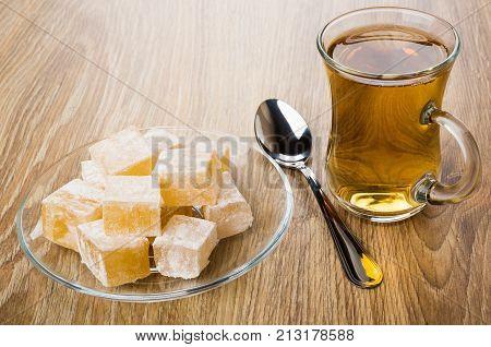 Rakhat-lukum In Saucer, Cup Of Tea And Teaspoon
