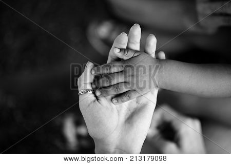 Hands of child and adult. Black and white hand. Trust and support motherhood and childhood parent and son or daughter. Children of Africa. Family and love between mother and child