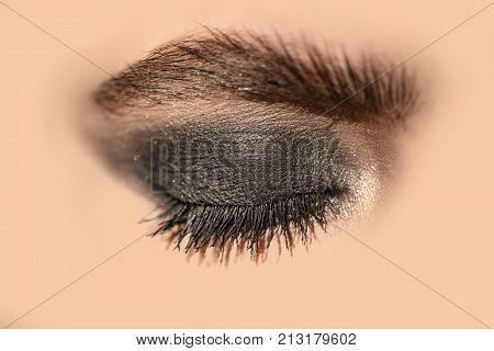 Eye makeup cosmetics concept of female beauty eyeshadow for young girl face girl close. One female eye with makeup closed eyebrows and eyelids beauty and clean healthy skin. Close eyes and dream