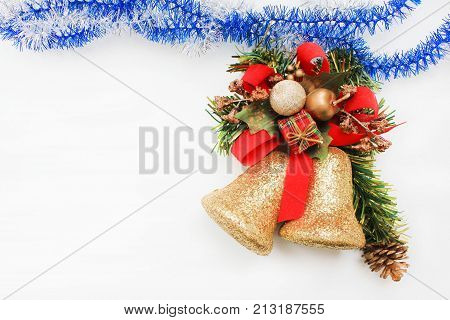 Merry Christmas and Happy New Year Card Design Background. Fir green tree with presents and jingle bells decoration. Holiday wallpaper theme composition with empty white copy space