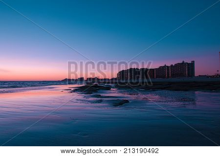 Sunset over a rocky beach in front the hotels at Puerto Penasco (Rocky Point) Mexico.