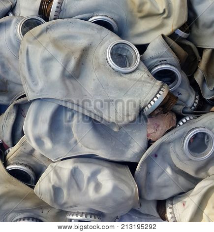 close up image of old rubber gas masks.
