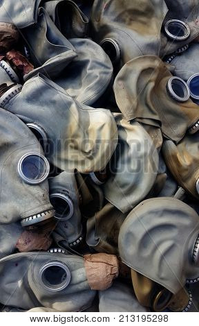 close up image of old rubber gas masks