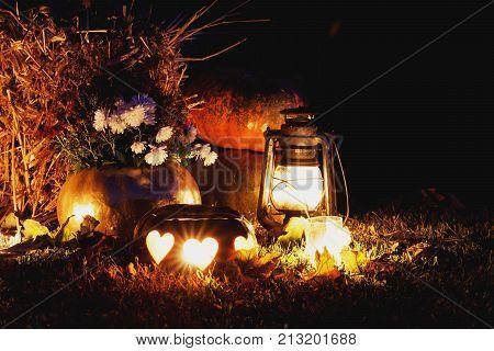 hallowen pumpkins decoration with candle in dark.