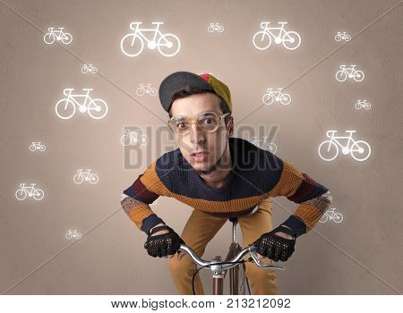 Young ridiculous biker with line drawn bikes on the background