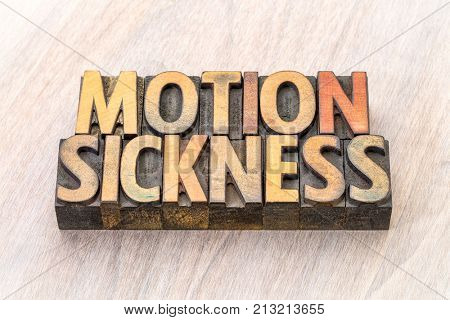 motion sickness  - word abstract in vintage letterpress wood type printing blocks