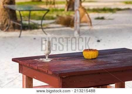 A Glass In The Sand On The Table, Varadero, Matanzas, Cuba. Copy Space For Text.
