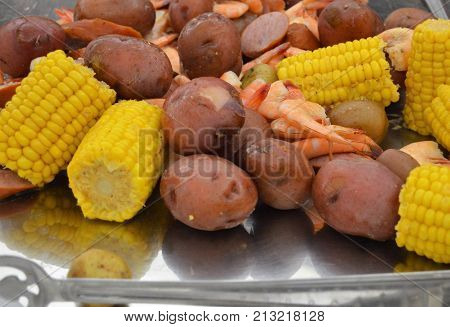 lowcountry boil on silver platter with spoon