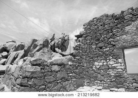 Bushiribana Gold Smelter ruins in black and white. North coast, Aruba Island, tourism, historic
