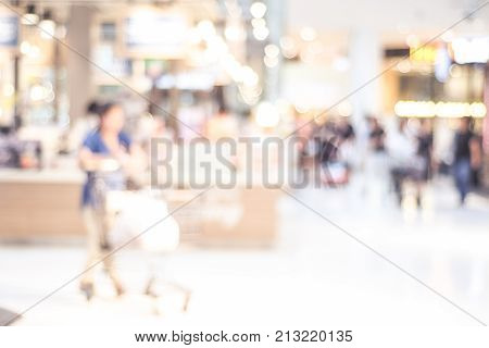 Blurred background Blur people motion buying grocery food and products in supermarket store with bokeh light background business concept