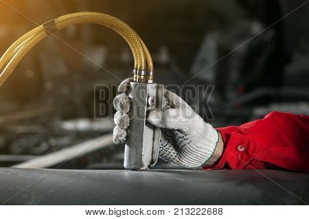 Man Controls The Control Panel Of The Pneumatic, Hydraulic Installation