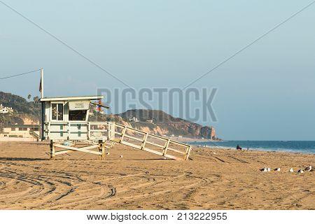 Lifeguard tower near sunset on Zuma Beach in Malibu, California.