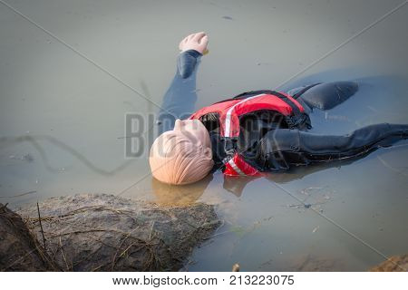 male model drowning wear life jacket on the water