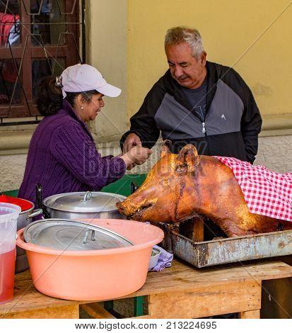 Vendor Sells Portion Of Hornado (pig) For Lunch