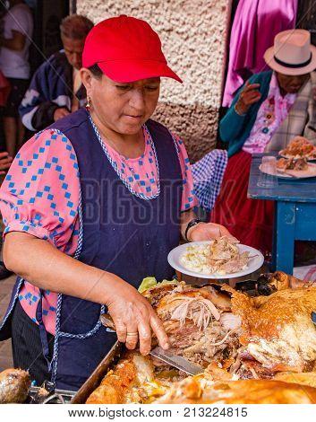 Vendor Prepares Hornado (pig) Lunch For Customer