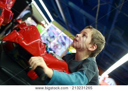 Boy Playing In Motorcycle Simulator