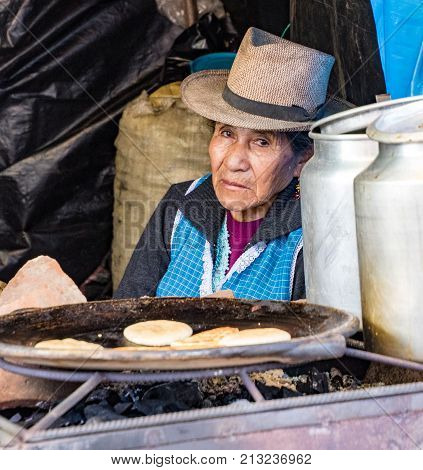 Vendor Looks Out From Her Stand Selling Pancakes
