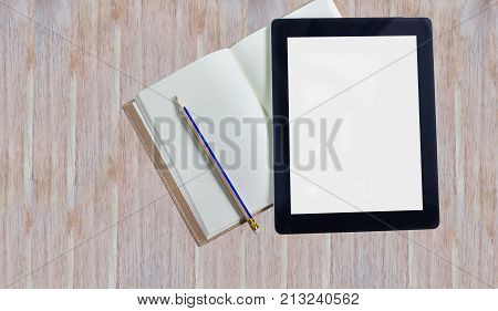 Big Blank Screen Tablet And Blank Note Book On Wooden Table