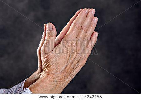 Wrinkly Hands Of  Elderly Woman Praying