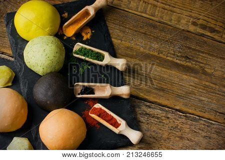 Color raw dough for pasta dumplings ravioli lasagna pelmeni. Organic natural dyes: cuttlefish ink red paprika turmeric and fresh herbs. Food concept