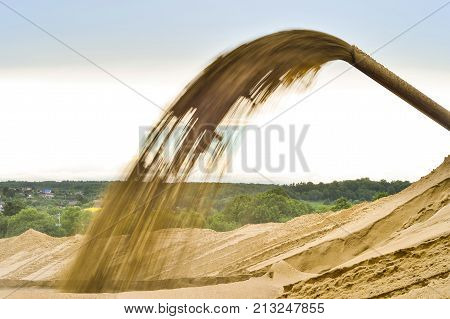 The Industrial extraction of sand for construction.