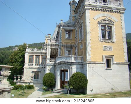 Old noble mansion with a park. Photo.