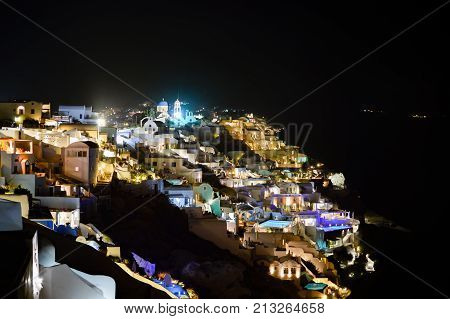 A Scenic Night View Of The City Of Thira In Santorini With Its Lights