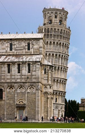 Leaning Tower of Pisa and Cathedral - Pisa Italy. The Leaning Tower of Pisa is the campanile or freestanding bell tower of the cathedral of the Italian city of Pisa.