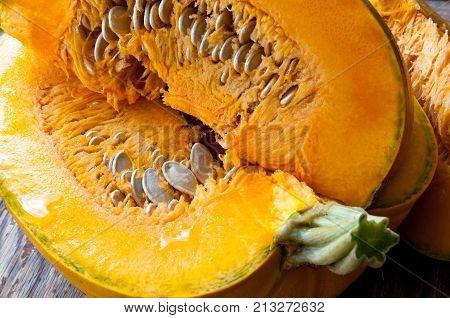 sliced pumpkin close-up, sliced pumpkin chunks on the table