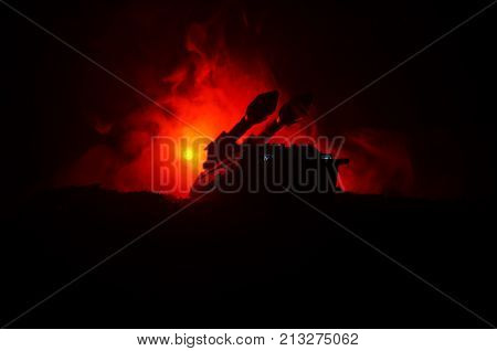 Rocket Launch With Fire Clouds. Battle Scene With Rocket Missiles With Warhead Aimed At Gloomy Sky A