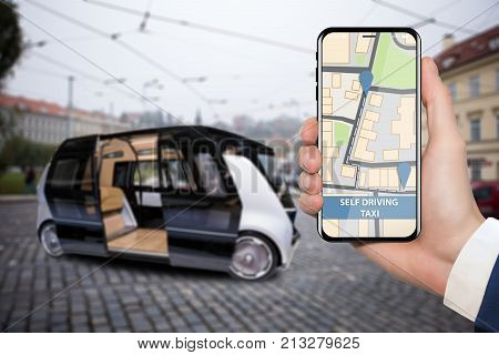 Control of self driving bus by mobile app. Hand with phone on a background of autonomous vehicle with open door.